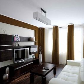 Модульная мебель темного цвета для современного зала