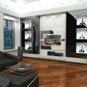 Черная мебель на деревянном полу