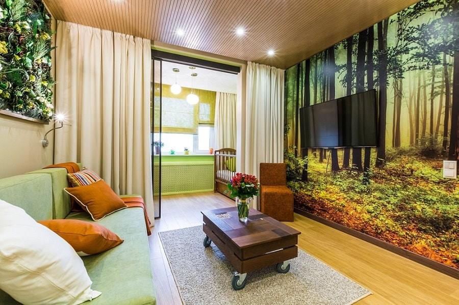 Телевизор на стене гостиной с фотообоями
