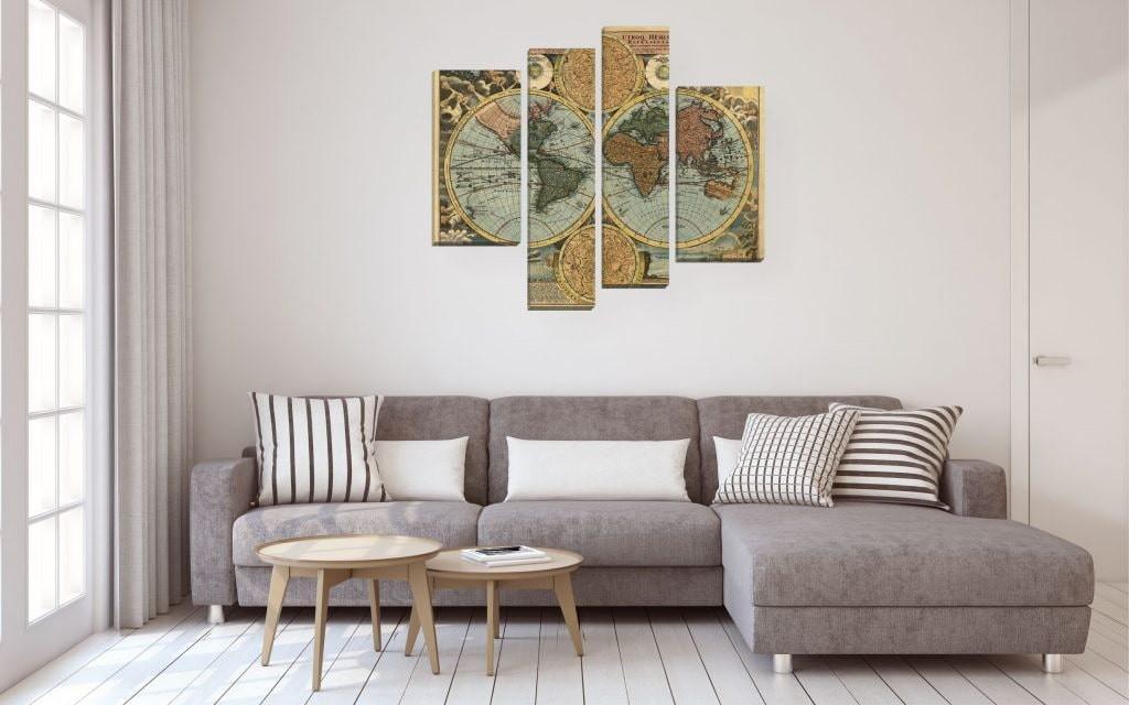 Угловой диван в гостиной с модульными картинами