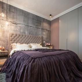 Серый бетон в интерьере спальни