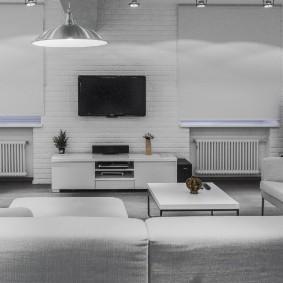 Интерьер гостиной комнаты в белом лофте