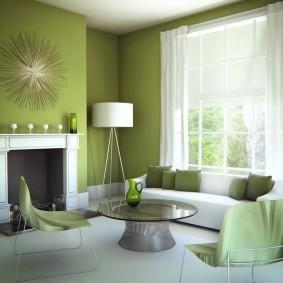 Белый торшер на фоне зеленых стен