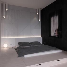 Спальное ложе в комнате минималистического стиля