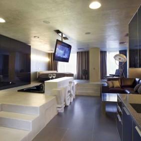 Дизайн квартиры студии с кухней на подиуме