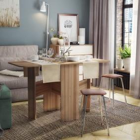 Интерьер гостиной со столом-книжкой