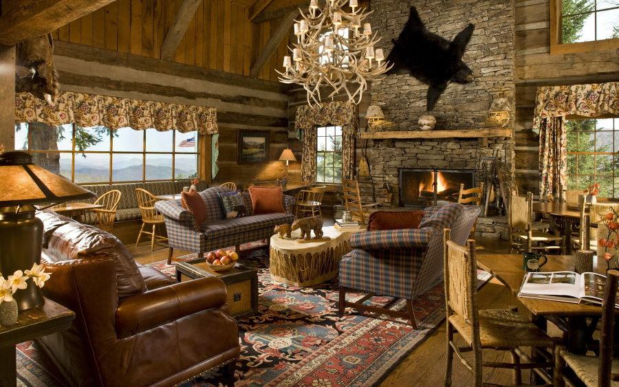Просторная гостиная в загородном доме из бревна