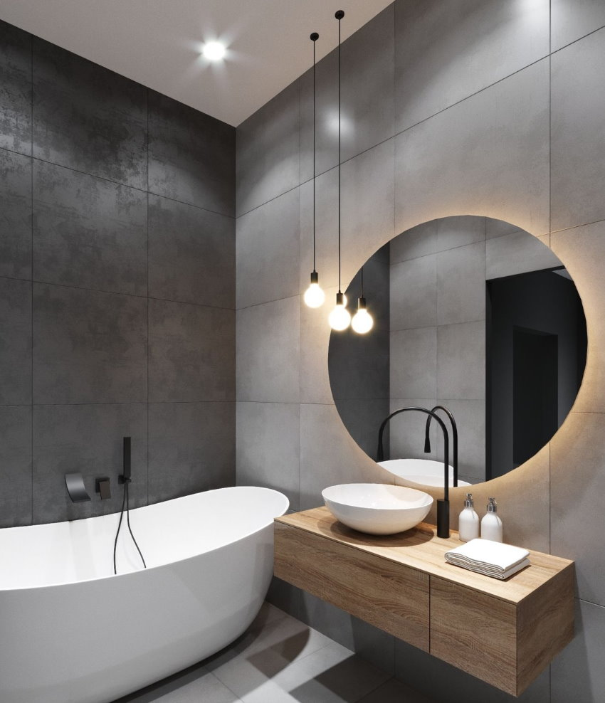 Круглое зеркало в компактной ванной стиля модерн