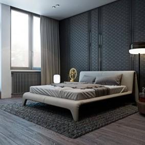 Стильная спальная комната с ламинатом серого цвета