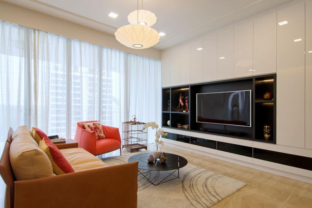 Глянцевые фасады мебели в зале современного стиля