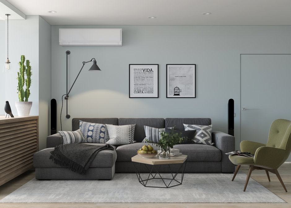 Угловой диван в зале панельного дома