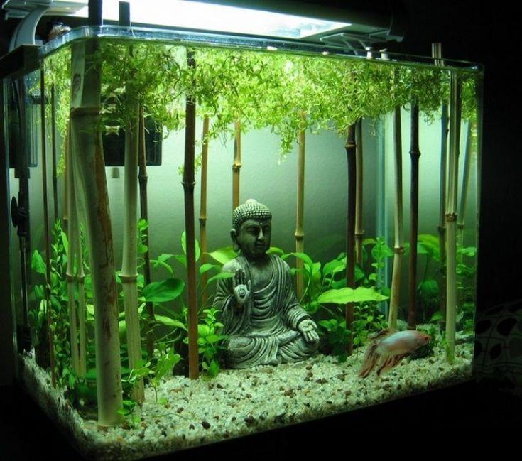 Декор небольшого аквариума статуэткой в восточном стиле