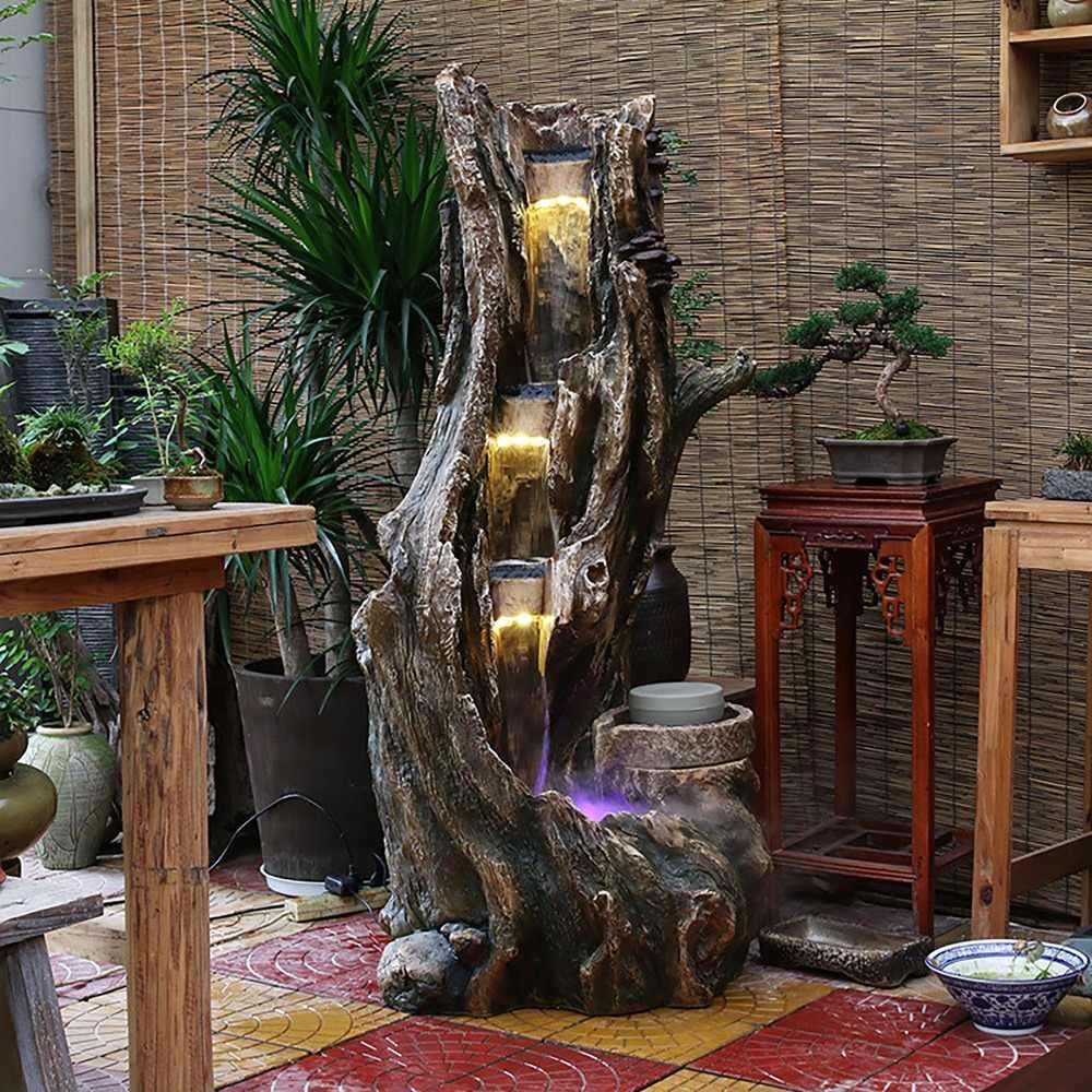 Интерьер гостиной с декоративным водопадом