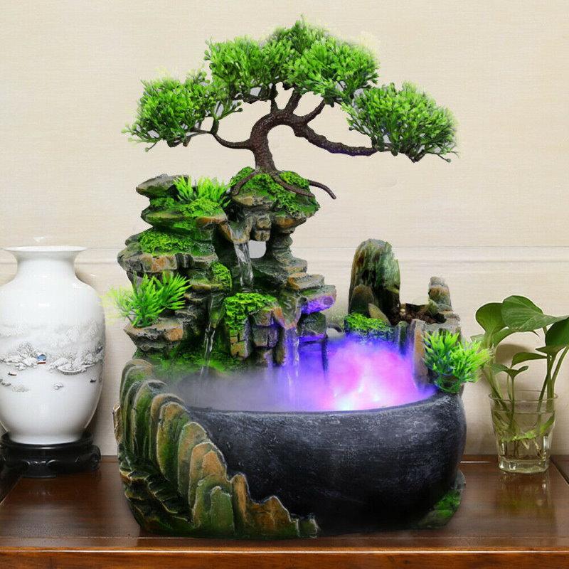 Декоративный фонтан с подсветкой и туманом