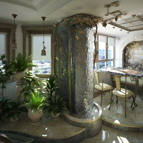 Комнатный сад с декоративным водопадом на стене