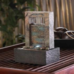 Миниатюрный фонтан из природного камня