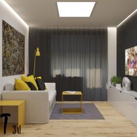 Желтые акценты в сером интерьере гостиной