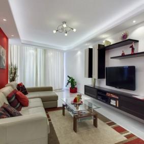 Темная мебель на светлой стене гостиной