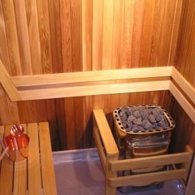 Печь-каменка в сауне с деревянной отделкой
