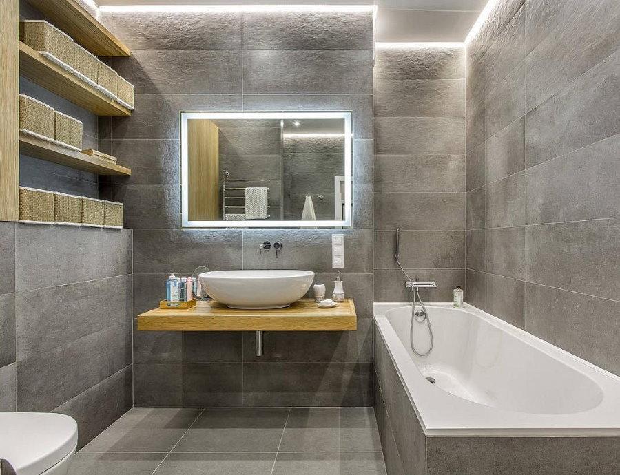 Серый керамогранит в совмещенной ванной комнате