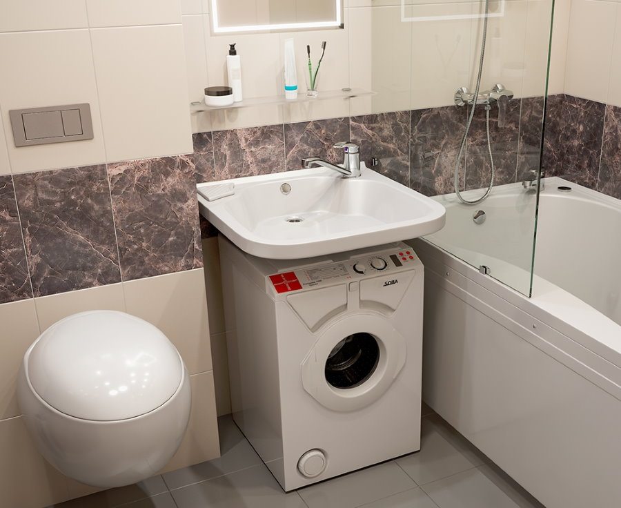 Место для стиральной машины под раковиной в ванной