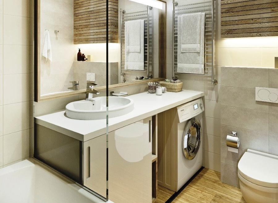 Размещение стиральной машины под белой столешницей
