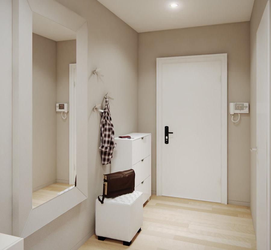 Белая мебель в коридоре стиля минимализма
