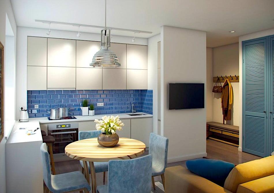 Обеденный стол круглой формы в кухне-гостиной