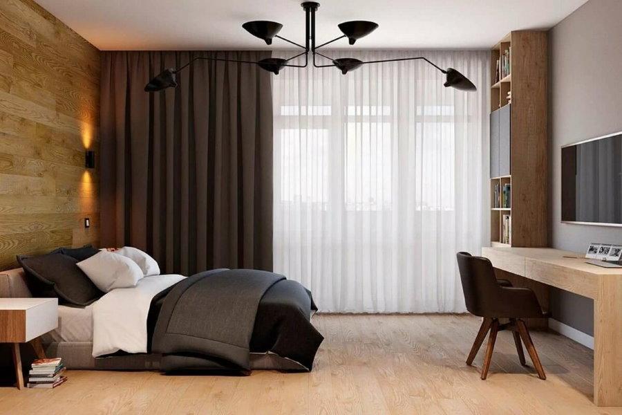 Темные шторы на окне мужской спальни