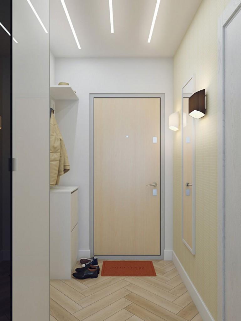Белая прихожая в узком коридоре квартиры