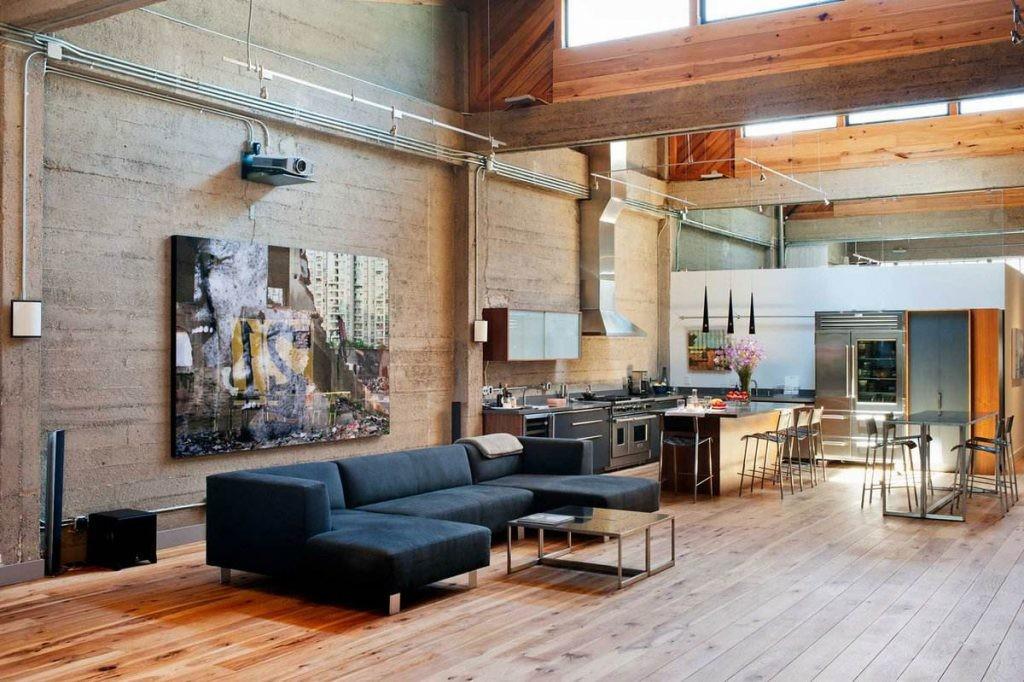 Декор картиной стены в комнате индустриального стиля