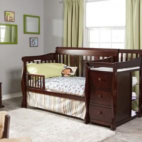 детская кровать с пеленальным столиком оформление