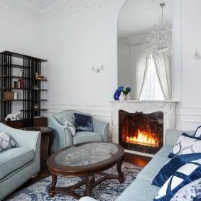 Камин в интерьере белой комнаты