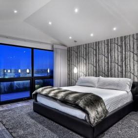 Панорамное окно в интерьере спальни