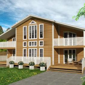 Деревянный дом с симметрично расположенными балконами