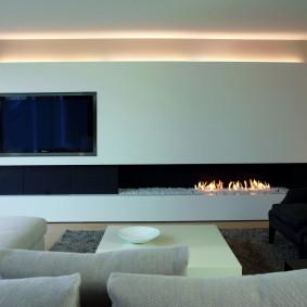 Интерьер комнаты в стиле минимализма с камином