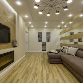 Освещение комнаты с ТВ-панелью и камином