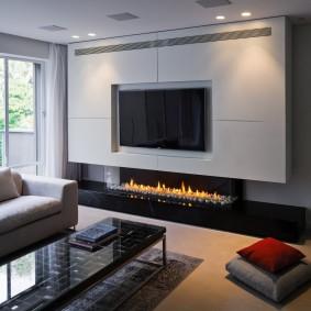 Встроенная плазма в гостиной стиля минимализм
