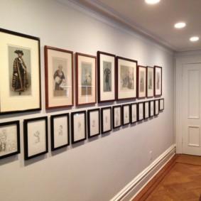 Изображения знаменитостей на картинах в коридоре