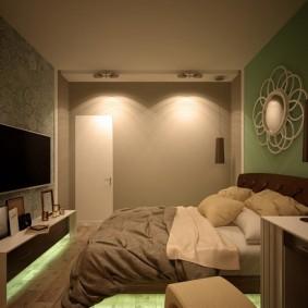 Телевизор на стене спальни небольшого размера