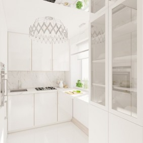Белая мебель на кухне в квартире