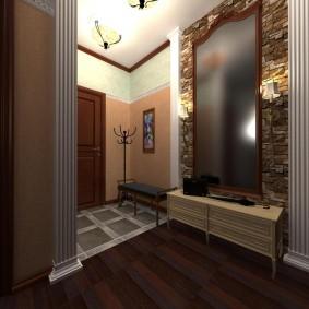 Искусственный камень вокруг зеркала в коридоре