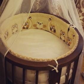 круглая детская кроватка интерьер