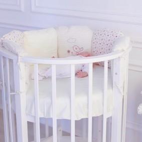 круглая детская кроватка интерьер фото