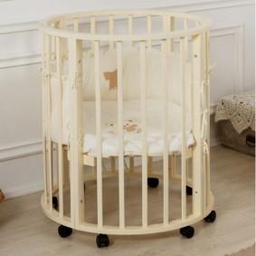 круглая детская кроватка виды