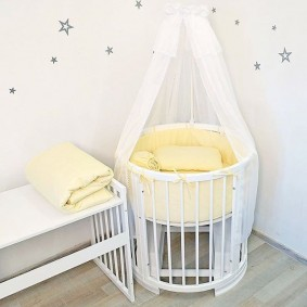 круглая детская кроватка виды фото