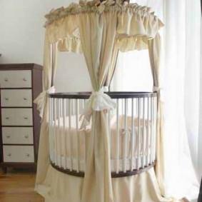 круглая детская кроватка виды оформления