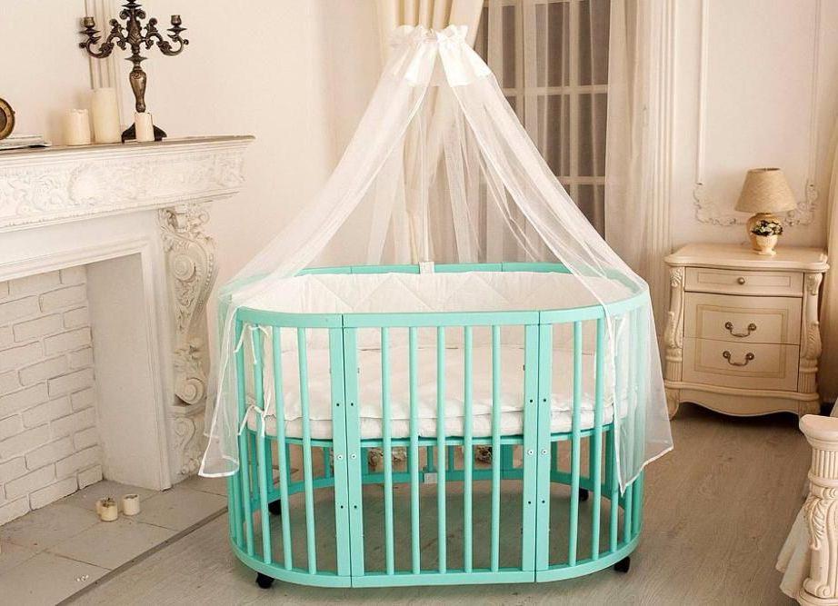 круглая детская кроватка в интерьере