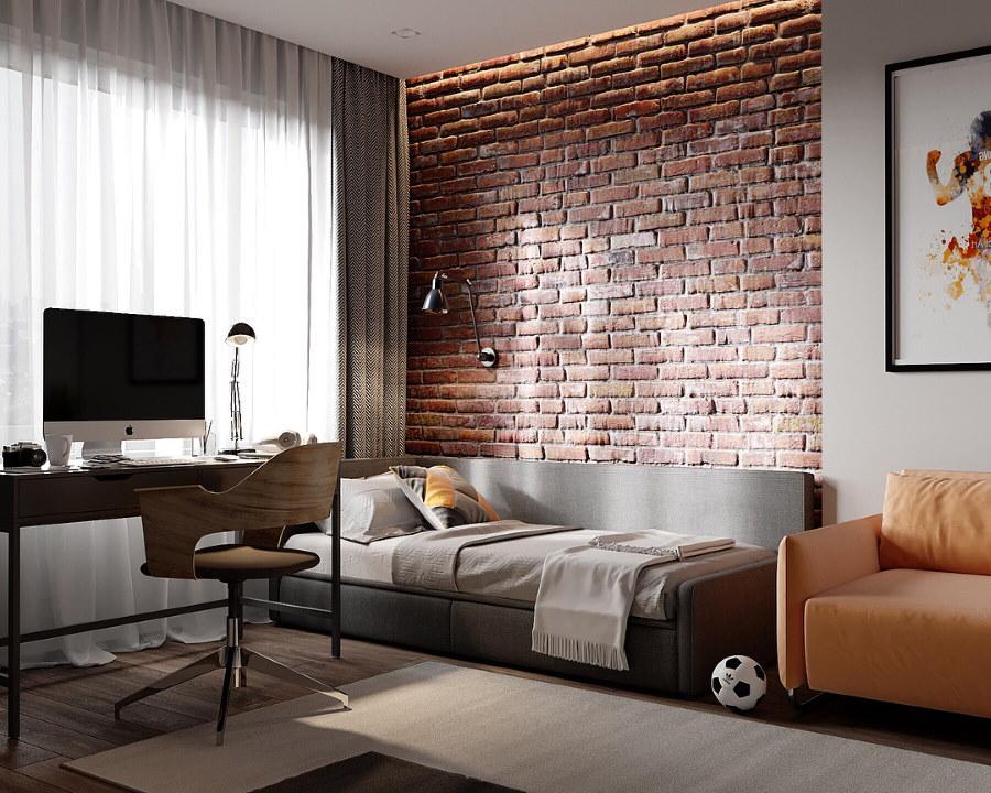 Серый диван возле кирпичной стены в комнате