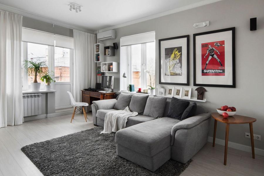 Интерьер гостиной комнаты с комбинированными шторами